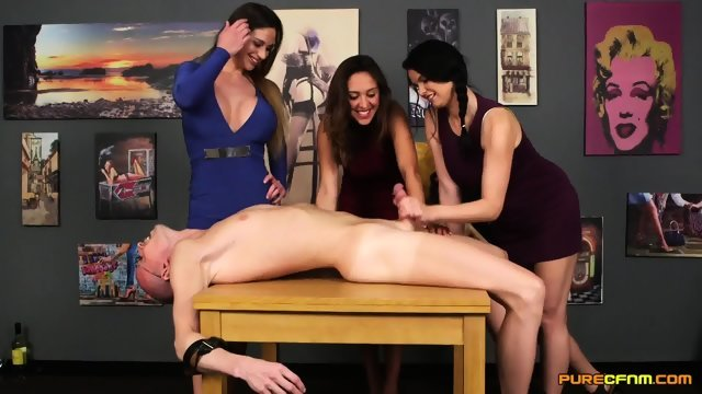 Three beauties put the man on the table and Jack off his cock