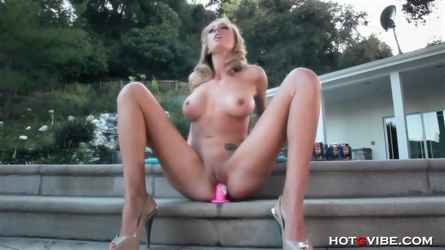 Adorable girl sits on sex toy