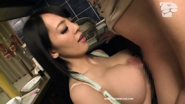 Big-breasted Asian girl sucks dick in the kitchen