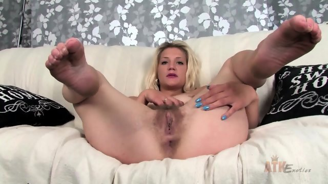 Blonde plays with her hairy pussy
