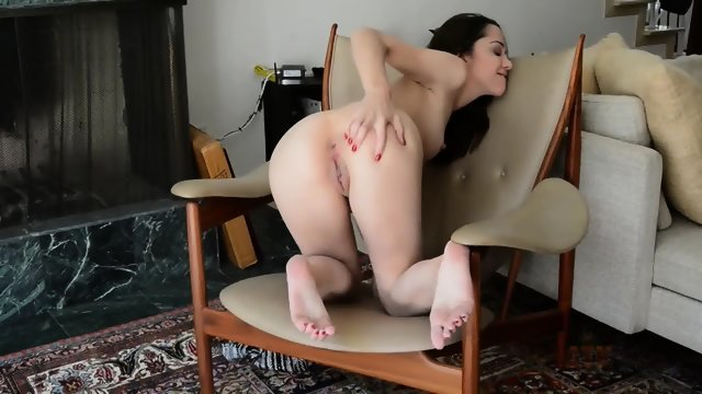 Brunette in a chair playing with twat