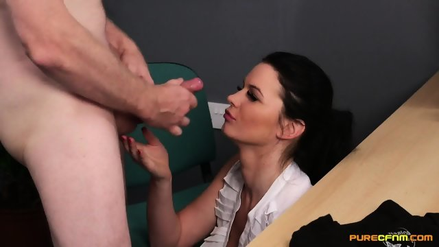 In the office brunette sucking cock