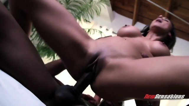 A Negro tumbles on the bed a sexy bitch